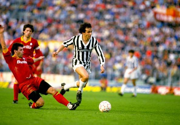 Michel Platini of Juventus and Sebastiano Nela of Roma AS