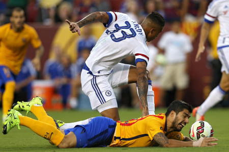 LANDOVER, MD - JULY 28: Luis Suarez #9 of Barcelona battles with Kenedy #33 of Chelsea for the ball in the first half during the International Champions Cup North America at FedExField on July 28, 2015 in Landover, Maryland. (Photo by Patrick Smith/Getty Images)