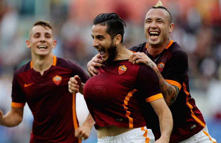 ROME, ITALY - SEPTEMBER 26: Kostas Manolas (C)of AS Roma celebrates with his teammates Lucas Digne (L) and Radja Nainngolan after scoring the opening goal during the Serie A match between AS Roma and Carpi FC at Stadio Olimpico on September 26, 2015 in Rome, Italy. (Photo by Paolo Bruno/Getty Images)