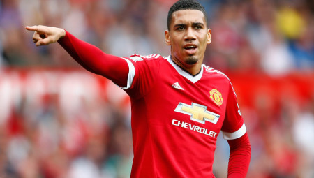 MANCHESTER, ENGLAND - AUGUST 22: Chris Smalling of Manchester United gives instructions during the Barclays Premier League match between Manchester United and Newcastle United at Old Trafford on August 22, 2015 in Manchester, United Kingdom. (Photo by Julian Finney/Getty Images)
