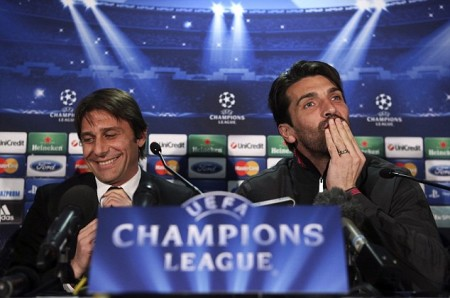 Juventus manager Antonio Conte (L) laughs as goalkeeper Gianluigi Buffon reacts during a news conference ahead of their Champions League soccer match against Celtic, at Celtic Park stadium in Glasgow, Scotland February 11, 2013. REUTERS/David Moir (BRITAIN - Tags: SPORT SOCCER)